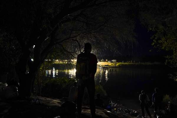 A Haitian migrant stands on the Mexican side of the border before crossing the Rio Grande to Del Rio, Texas, from Ciudad Acuna, Thursday, Sept. 23, 2021. (AP Photo/Fernando Llano)