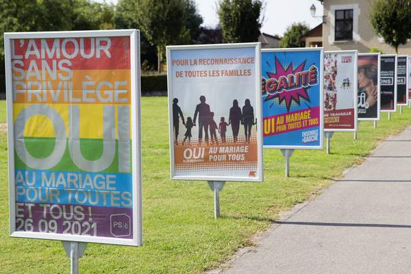 Posters of political parties and associations showing their slogans in Perly near Geneva, Saturday Sept. 25, 2021. (Salvatore Di Nolfi/Keystone via AP)
