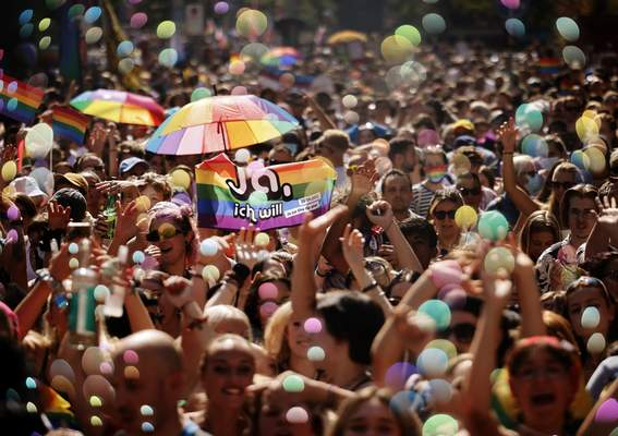 FILE - In this Saturday, Sept. 4, 2021 file photo, people take part in the Zurich Pride parade in Zurich, Switzerland, with the slogan Dare. Marriage for all, now! (Trau Dich. Ehe fuer alle. Jetzt!) for the rights of the LGBTIQ community. (Michael Buholzer/Keystone via AP, File)