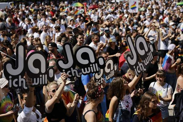 FILE - In this Saturday, Sept. 4, 2021 file photo, people gather for the Zurich Pride parade in Zurich, Switzerland. (Michael Buholzer/Keystone via AP, File)