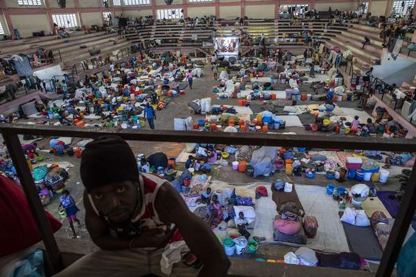 Internally displaced people due to gang violence shelter in the Center Sportif of Carrefour, in Port-au-Prince, Haiti, Saturday, Sept. 18, 2021. (AP Photo/Rodrigo Abd)