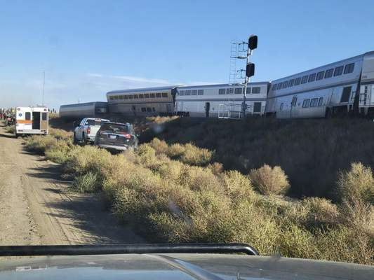 In this photo provided by Kimberly Fossen an ambulance is parked at the scene of an Amtrak train derailment on Saturday, Sept. 25, 2021, in north-central Montana. (Kimberly Fossen via AP)