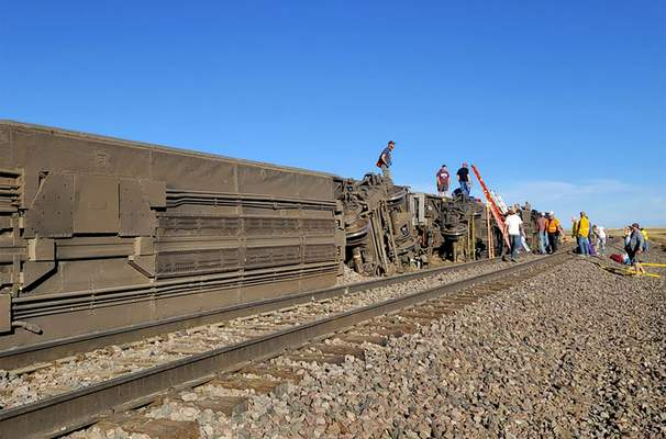 In this photo provided by Kimberly Fossen people work at the scene of an Amtrak train derailment on Saturday, Sept. 25, 2021, in north-central Montana. (Kimberly Fossen via AP)