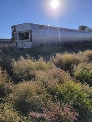 This photo provided by Kimberly Fossen shows an Amtrak train that derailed on Saturday, Sept. 25, 2021, in north-central Montana. (Kimberly Fossen via AP)