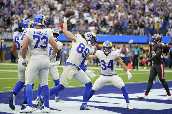 Associated Press Los Angeles Rams tight end Tyler Higbee celebrates after his touchdown catch Sunday against the Tampa Bay Buccaneers.