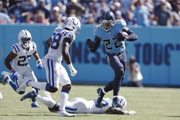 Associated Press Titans running back Derrick Henry tries to get past Colts inside linebacker Bobby Okereke in the second half Sunday in Nashville, Tenn. Henry finished with 113 yards on 28 carries.