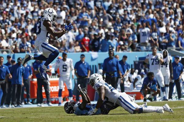Associated Press Colts cornerback Kenny Moore II intercepts a pass intended for Titans wide receiver Chester Rogers, on the ground, in the first half Sunday.