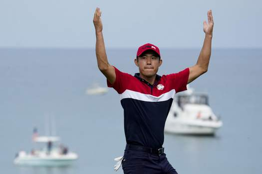 APTOPIX Ryder Cup Golf Associated Press American Collin Morikawa reacts after winning the 17th hole during his Ryder Cup singles match Sunday. (Ashley LandisSTF)