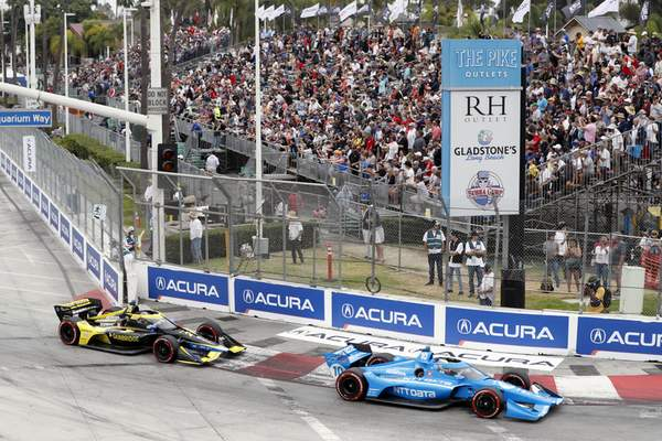 Associated Press Alex Palou leads Colton Herta into Turn 1 during Sunday's IndyCar race in Long Beach, Calif. Palou won the IndyCar title. Herta won the race.
