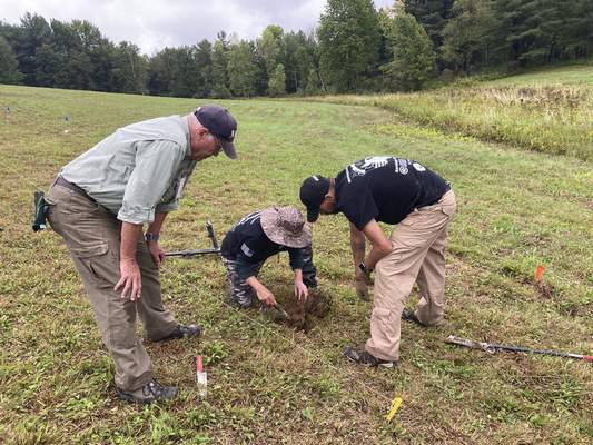 Associated Press Volunteer trainer Bill Rose watches veterans Katherine Kuzmick and Bjorn Bruckshaw work at an archaeological dig this month at the site of the Second Battle of Saratogain Stillwater, N.Y.