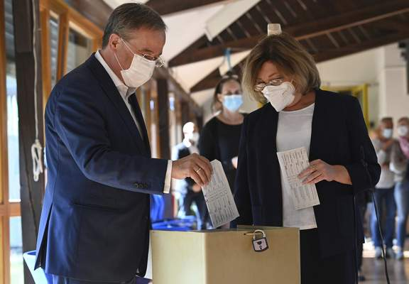 Associated Press Armin Laschet, left, Christian Democratic Union candidate, and his wife, Susanne, cast their votes Sunday for the German parliament election in Aachen, Germany.