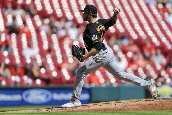 Pittsburgh Pirates' Connor Overton throws during the first inning of a baseball game against the Cincinnati Reds in Cincinnati, Monday, Sept. 27, 2021. (AP Photo/Aaron Doster)