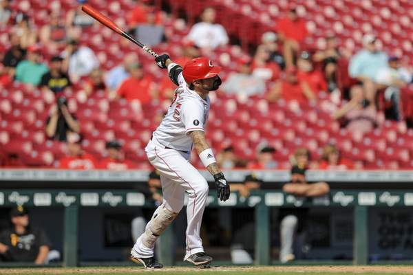 Cincinnati Reds' Nick Castellanos watches his three-run home run during the sixth inning of a baseball game against the Pittsburgh Pirates in Cincinnati, Monday, Sept. 27, 2021. (AP Photo/Aaron Doster)