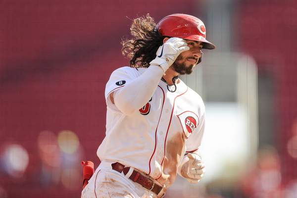 Cincinnati Reds' Jonathan India fixes his hair as he runs the bases after hitting a two-run home run during the seventh inning of a baseball game against the Pittsburgh Pirates in Cincinnati, Monday, Sept. 27, 2021. (AP Photo/Aaron Doster)