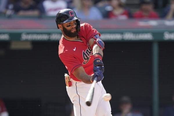 Cleveland Indians' Amed Rosario hits an RBI-single in the sixth inning of a baseball game against the Kansas City Royals, Monday, Sept. 27, 2021, in Cleveland. (AP Photo/Tony Dejak)