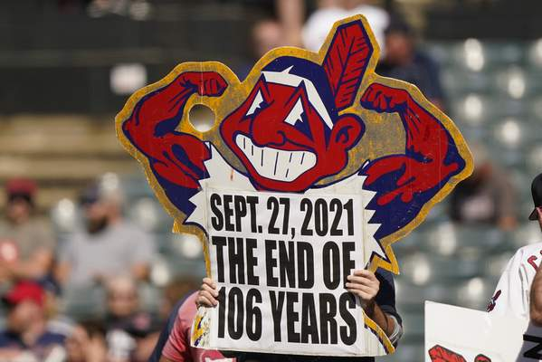 A Cleveland Indians fan holds up a sign during a baseball game between the Kansas City Royals and the Cleveland Indians, Monday, Sept. 27, 2021, in Cleveland. Cleveland plays its final home game against the Royals as the Indians, the team's nickname since 1915. The club will be called the Cleveland Guardians next season. (AP Photo/Tony Dejak)