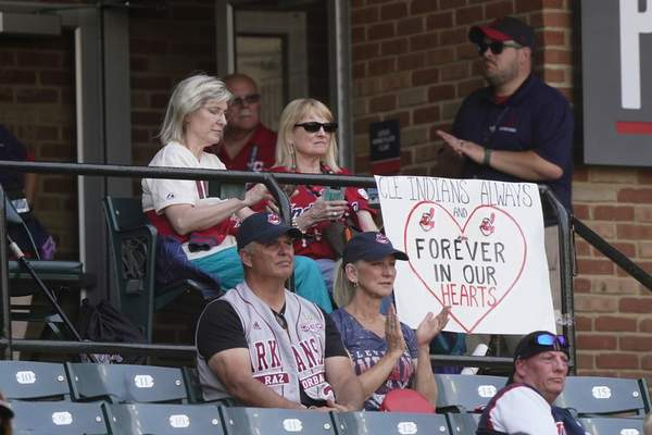 Cleveland Indians fans display a sign during a baseball game between the Kansas City Royals and the Cleveland Indians, Monday, Sept. 27, 2021, in Cleveland. Cleveland plays its final home game against the Royals as the Indians, the team's nickname since 1915. The club will be called the Cleveland Guardians next season. (AP Photo/Tony Dejak)