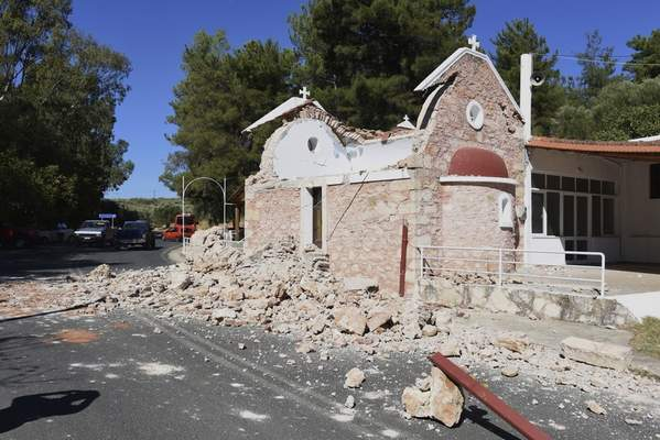A damaged Greek Orthodox chapel is seen after a strong earthquake in Arcalochori village on the southern island of Crete, Greece, Monday, Sept. 27, 2021. A strong earthquake with a preliminary magnitude of 5.8 has struck the southern Greek island of Crete, and Greek authorities say one person has been killed and several more have been injured. (AP Photo/Harry Nikos)