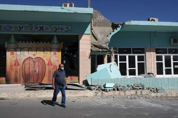 A man stands outside a damaged building after a strong earthquake in Arkalochori village on the southern island of Crete, Greece, Monday, Sept. 27, 2021. A strong earthquake with a preliminary magnitude of 5.8 has struck the southern Greek island of Crete, and Greek authorities say one person has been killed and several more have been injured. (AP Photo/Harry Nikos)