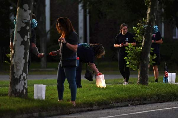 People light candles along Blue Point Ave. in Blue Point, NY in memory of Gabby Petito, Friday, Sept. 24, 2021. (Steve Pfost/Newsday via AP)