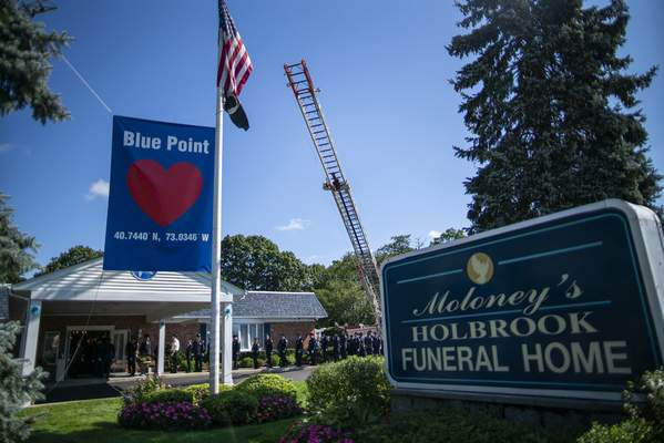 Long Island firefighters attend the funeral home viewing of Gabby Petito at Moloney's Holbrook Funeral Home in Holbrook, N.Y. Sunday, Sept. 26, 2021. (AP Photo/Eduardo Munoz Alvarez)