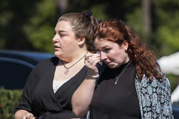 A woman wipes her tears after attending the funeral home viewing of Gabby Petito at Moloney's Funeral Home in Holbrook, N.Y. Sunday, Sept. 26, 2021. (AP Photo/Eduardo Munoz Alvarez)
