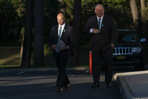 Gabby Petito's stepdad Jim Schmidt, left, exits Moloney's Funeral Home at the end of the funeral home viewing for Petito in Holbrook, N.Y. Sunday, Sept. 26, 2021. Lines of mourners paid their respects Sunday for Petito, the 22-year-old whose death on a cross-country trip has sparked a manhunt for her boyfriend. (AP Photo/Eduardo Munoz Alvarez)