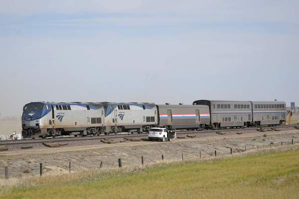 Engines and cars from an Amtrak train that derailed a day earlier are shown Sunday, Sept. 26, 2021, at the derailment site just west of Joplin, Mont. (AP Photo/Ted S. Warren)
