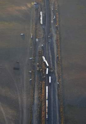 This aerial view taken Sunday, Sept. 26, 2021, shows an Amtrak train that derailed in north-central Montana Saturday that killed multiple people and left others hospitalized, officials said. (Larry Mayer/The Billings Gazette via AP)