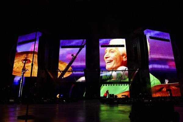 A video tribute to Charlie Watts plays before the Rolling Stones perform during the No Filter tour at The Dome at America's Center on Sunday, Sept. 26, 2021, in St. Louis. (Photo by Amy Harris/Invision/AP)