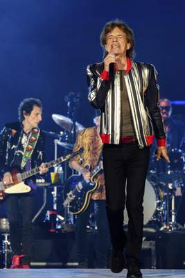 Ronnie Wood, left, and Mick Jagger of the Rolling Stones perform during the No Filter tour at The Dome at America's Center, Sunday, Sept. 26, 2021, in St. Louis. (Photo by Amy Harris/Invision/AP)