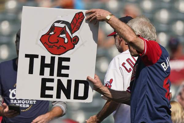 Associated Press An Indians fan holds up a sign during Monday's final home game of the season in Cleveland against the Kansas City Royals. The Cleveland team will be known as the Guardians next season.