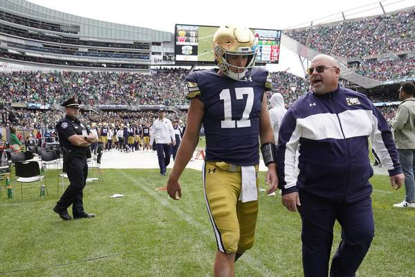 Associated Press Notre Dame quarterback Jack Coan heads to the locker room after an ankle injury Saturday.