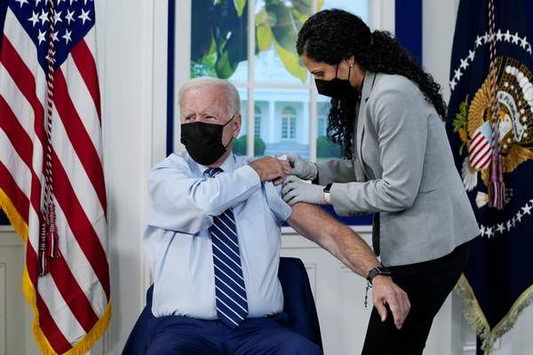 Associated Press President Joe Biden receives a COVID-19 booster shot Monday in the South Court Auditorium at the White House in Washington.