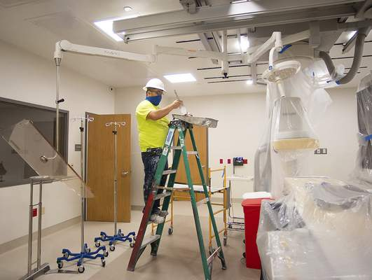 Katie Fyfe | The Journal Gazette Baldemar Perez paints Monday at Lutheran Downtown Hospital. The hospital will be ready to start treating patients Nov. 13.