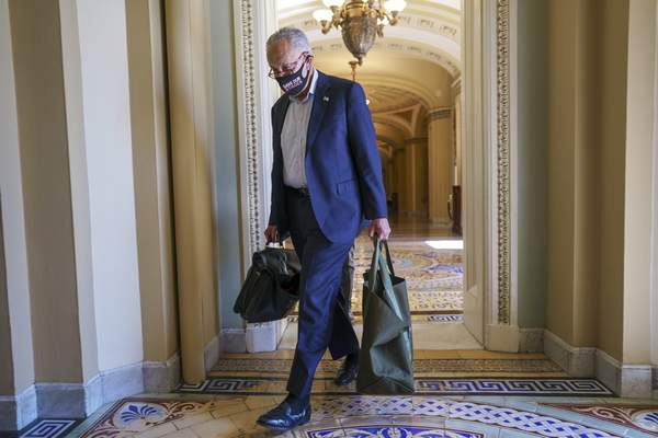 Associated Press Senate Majority Leader Chuck Schumer, D-N.Y., arrives at the Capitol on Monday as a consequential week begins for President Joe Biden's agenda.