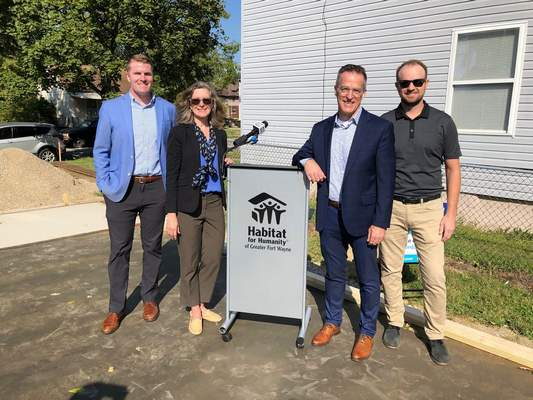 Courtesy  Habitat for Humanity of Greater Fort Wayne and Vincent Village announce a partnership that will provide a three-bedroom home for families in transition. From left to right is Andrew Gritzmaker of Habitat for Humanity; Cheryl Chalfant of the Mary Cross Tippmann Family Foundation; John Christensen of the Vincent Village Board of Directors; and Matt Streicher of Tippman Construction.