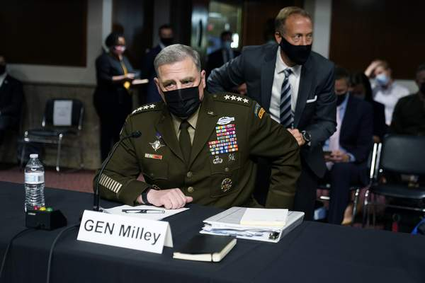 Chairman of the Joint Chiefs of Staff Gen. Mark Milley arrives before a Senate Armed Services Committee hearing on the conclusion of military operations in Afghanistan and plans for future counterterrorism operations, Tuesday, Sept. 28, 2021, on Capitol Hill in Washington. (AP Photo/Patrick Semansky, Pool)