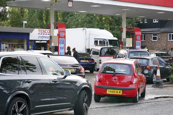 Drivers queue for fuel at a petrol station in Birmingham, England, Tuesday, Sept. 28, 2021. (AP Photo/Jacob King)