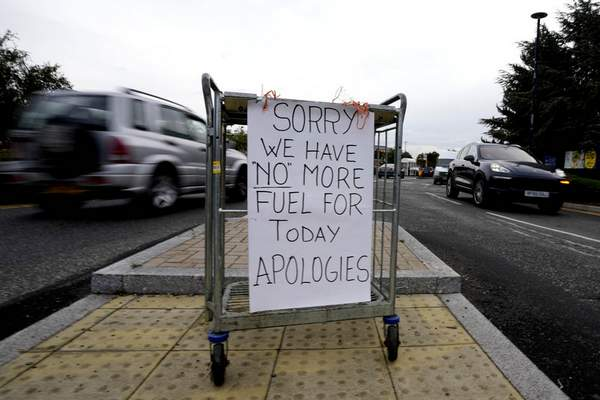 A sign referring to the lack of fuel is placed at the entrance to a petrol station in London, Tuesday, Sept. 28, 2021. (AP Photo/Frank Augstein)