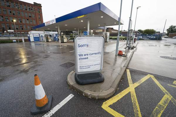 A closed petrol station in Manchester, England, Tuesday, Sept. 28, 2021. (AP Photo/Jon Super)