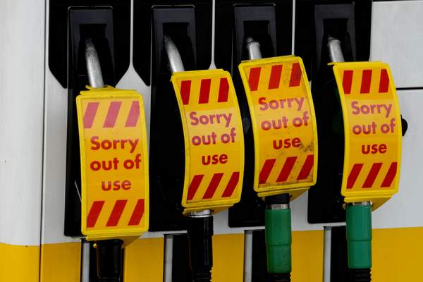 Closed fuel pumps at a petrol station in London, Tuesday, Sept. 28, 2021. (AP Photo/Frank Augstein)