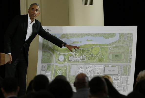 FILE - In this May 3, 2017, file photo, former President Barack Obama points to a rendering for the former president's lakefront presidential center at a community event at the South Shore Cultural Center in Chicago. (AP Photo/Nam Y. Huh, File)