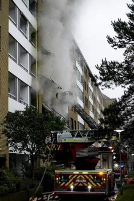 Emergency services attend the scene of an apartment building after an explosion in Annedal, central Gothenburg, Sweden, Tuesday Sept. 28, 2021. (Bjorn Larsson Rosvall/TT via AP)