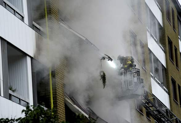 Smoke billows from an apartment building after an explosion in Annedal, central Gothenburg, Sweden, Tuesday Sept. 28, 2021. (Bjorn Larsson Rosvall/TT via AP)