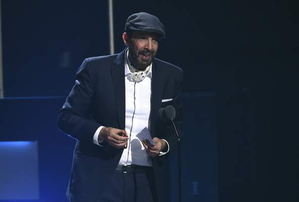 FILE - Juan Luis Guerra accepts the award for best contemporary/tropical fusion album for Literal at the 20th Latin Grammy Awards in Las Vegas on Nov. 14, 2019. (AP Photo/Chris Pizzello, File)
