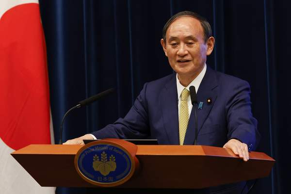 Japan's Prime Minister Yoshihide Suga speaks during a press conference at the prime minister's official residence Tuesday, Sept. 28, 2021, in Tokyo. (Rodrigo Reyes Marin/Pool Photo via AP)