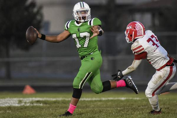 Mike Moore | The Journal Gazette South Side quarterback Larrenz Tabron looks for a receiver Friday in the first quarter against North Side.