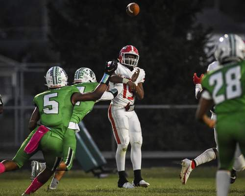 Mike Moore | The Journal Gazette North Side quarterback Donovan Williams passes the ball in the first quarter against South Side on Friday.