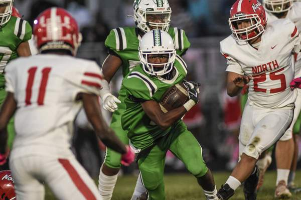 Mike Moore | The Journal Gazette South Side running back Anthony Thomas advances the ball in the first quarter against North Side on Friday.